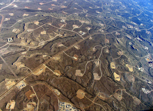 many fracking sites aerial view desolate land
