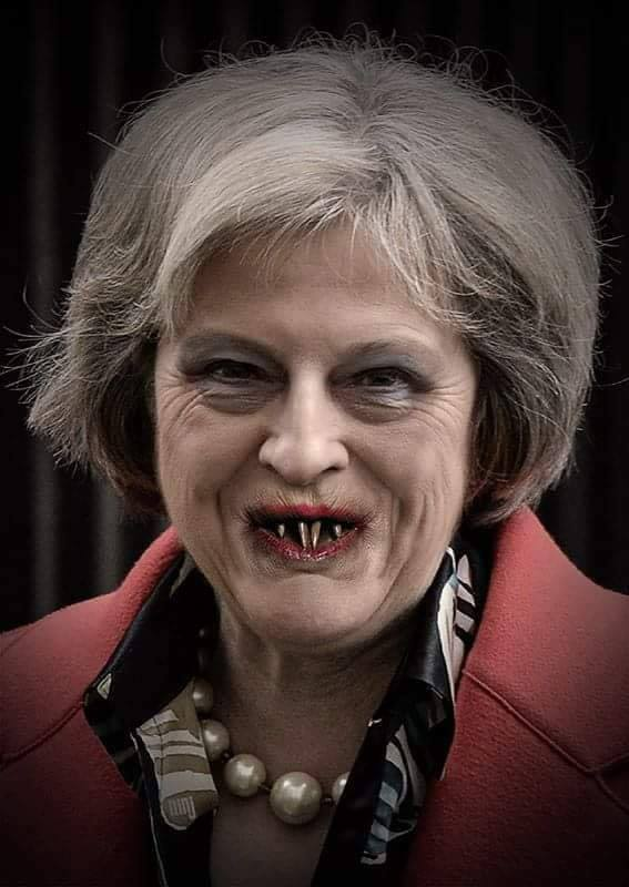 theresa may with vampire teeth